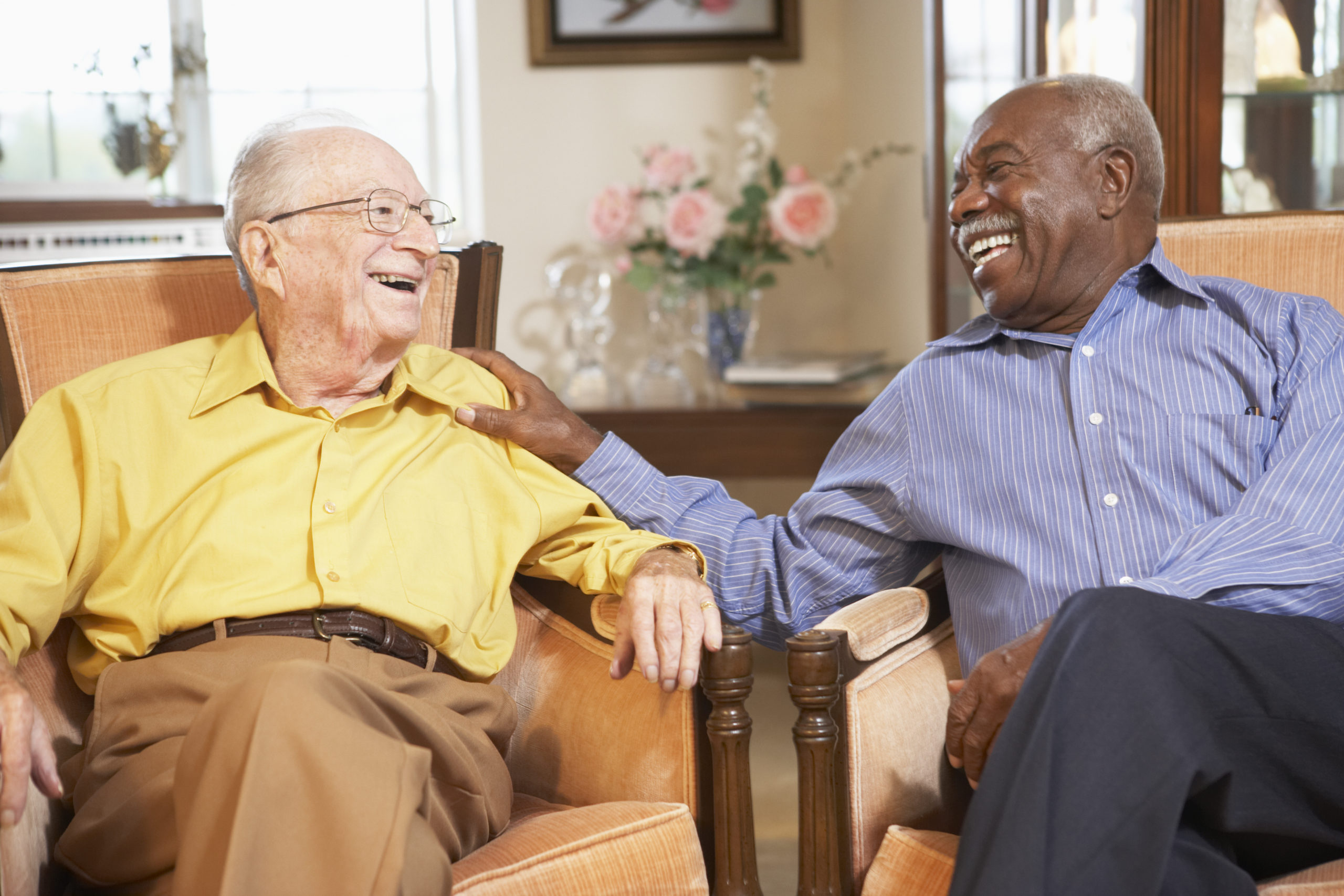 Two older men smiling